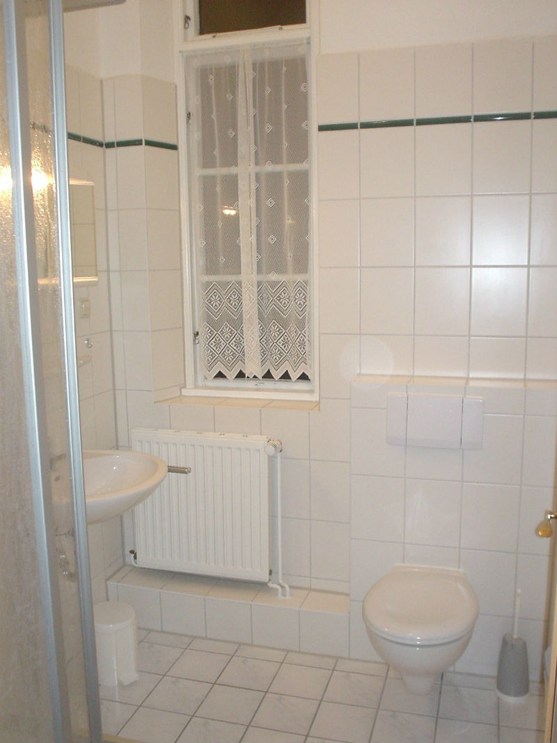 One of the 3 bathrooms with a shower